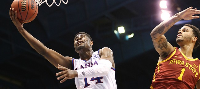 Kansas guard Malik Newman (14) gets in for a bucket against Iowa State guard Nick Weiler-Babb (1) during the second half, Tuesday, Jan. 9, 2018 at Allen Fieldhouse.