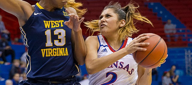 Kansas guard Brianna Osorio (2) tries to push past West Virginia forward Kristina King (13) late in the second quarter of Wednesday's game at Allen Fieldhouse.