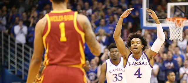 Kansas guard Devonte' Graham (4) raises up the Fieldhouse as Iowa State guard Nick Weiler-Babb (1) brings the ball up the court during the first half, Tuesday, Jan. 9, 2018.