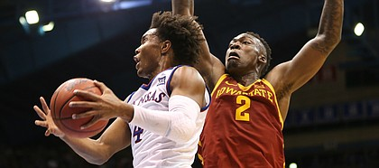 Kansas guard Devonte' Graham (4) gets to the bucket past Iowa State forward Cameron Lard (2) during the second half, Tuesday, Jan. 9, 2018 at Allen Fieldhouse.
