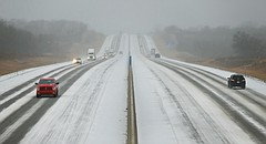 Cars travel on the Kansas Turnpike between Lawrence and Topeka, Kan., Thursday, Jan. 11, 2018, as freezing rain turns to light snow. (Chris Neal/The Topeka Capital-Journal via AP)