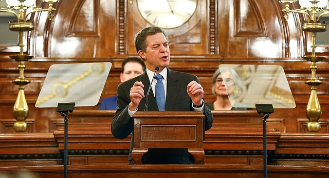 Kansas Gov. Sam Brownback discusses school finance while giving his final State of the State address Tuesday, Jan 1, 2018, on the floor of the Kansas House in Topeka, Kan. (Chris Neal/The Topeka Capital-Journal via AP)