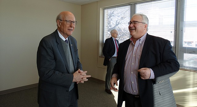 U.S. Sen. Pat Roberts, R-Kan., tours a newly redeveloped senior apartment complex in Topeka Friday with Rick Kready, a senior vice president of Pioneer Group, which is redeveloping the former Santa Fe Hospital into apartments.