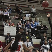 Lawrence High senior Talima Harjo shoots a floater in the lane in the second half of the Lions' 62-30 win over Shawnee Mission North on Friday.