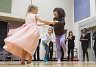 Children dance while the St. Luke's A.M.E. Church choir performs Tuesday, Jan. 20, 2015, during the annual Martin Luther King Jr., chili feed at New York Elementary School.