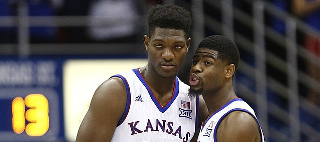 Kansas guard Malik Newman (14) pulls in Kansas forward Silvio De Sousa (22) for a chat as he checks into the game for the first time during the first half, Saturday, Jan. 13, 2018 at Allen Fieldhouse.