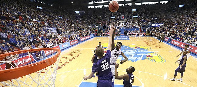 Kansas center Udoka Azubuike (35) turns for a shot over Kansas State forward Dean Wade (32) and Kansas State forward Makol Mawien (14) during the second half, Saturday, Jan. 13, 2018 at Allen Fieldhouse.