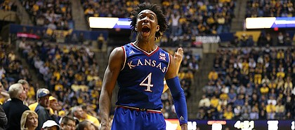 Kansas guard Devonte' Graham (4) explodes after a game-tying three-pointer late the second half, Monday, Jan. 15, 2018 at WVU Coliseum in Morgantown, West Virginia.