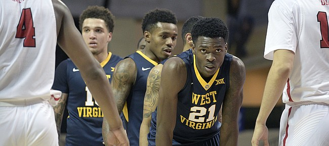 West Virginia forward Wesley Harris (21) sets up for a play in front of Marist forward Isaiah Lamb (4) and forward Aleksandar Dozic, right, during the second half of an NCAA college basketball game at the AdvoCare Invitational tournament Thursday, Nov. 23, 2017, in Lake Buena Vista, Fla. West Virginia won 84-78.