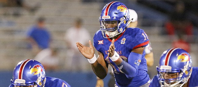 Kansas quarterback Tyriek Starks (18) waits for the snap during the fourth quarter on Saturday, Sept. 2, 2017 at Memorial Stadium.