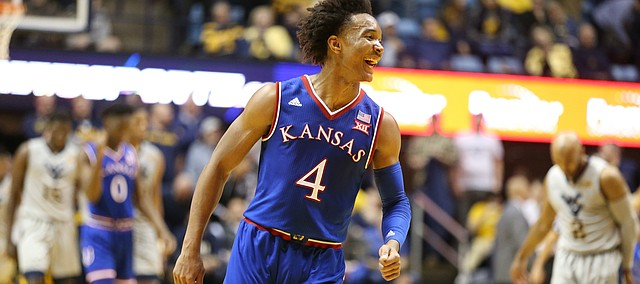 Kansas guard Devonte' Graham (4) and the Jayhawks celebrate their 71-66 win over West Virginia as time expires, Monday, Jan. 15, 2018 at WVU Coliseum in Morgantown, West Virginia.