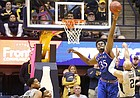 Kansas center Udoka Azubuike (35) defends against a shot from West Virginia guard Jevon Carter (2) during the second half, Monday, Jan. 15, 2018 at WVU Coliseum in Morgantown, West Virginia.