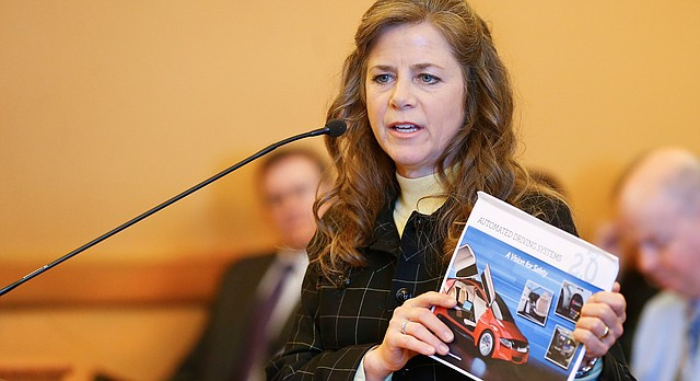 Susan deCourcy of the National Highway Traffic Safety Administration gives a presentation on autonomous vehicles on Tuesday, Jan. 16, 2018, while speaking with the Kansas House Transportation Committee at the Kansas Statehouse in Topeka, Kan. (Chris Neal/The Topeka Capital-Journal via AP)