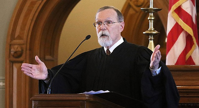 Kansas Supreme Court Chief Justice Lawton Nuss, gave his annual State of the Judiciary speech Wednesday afternoon, Jan. 17, 2018, during a joint session of the House and Senate in the House chamber. (Thad Allton /The Topeka Capital-Journal via AP)