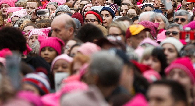 Protestors stand at the Women's March on Washington during the first full day of Donald Trump's presidency, Saturday, Jan. 21, 2017 in Washington. (AP Photo/John Minchillo)