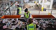 Workers sort through recycling materials on a conveyor belt as they are sent through a complex sorting machine on Wednesday, Feb. 17, 2016 at the Hamm's Recycling Facility, 26195 Linwood Road.