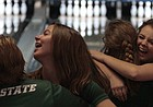 Free State's Nikki Miele (right) flashes a big smile after rolling a strike to send the Firebirds past Topeka West in the first game of the FSHS Invitational match play semifinals on Friday at Royal Crest Lanes. Miele rolled three strikes on the 10th frame to help the Firebirds' win Game 1 against Topeka West by one pin.