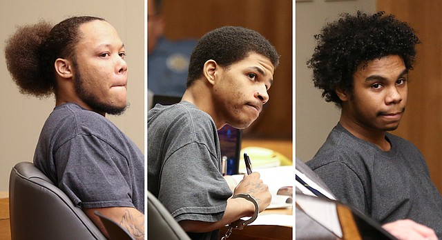 From left, defendants Anthony L. Roberts Jr., Ahmad M. Rayton and Dominique J. McMillon sit during a joint preliminary hearing, Thursday, Jan. 11, 2018, for charges related to a October 2017 triple homicide on Massachusetts Street.