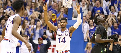 Kansas guard Malik Newman (14) holds up his hands as the buzzer sounds, Saturday, Jan. 20, 2018 at Allen Fieldhouse.