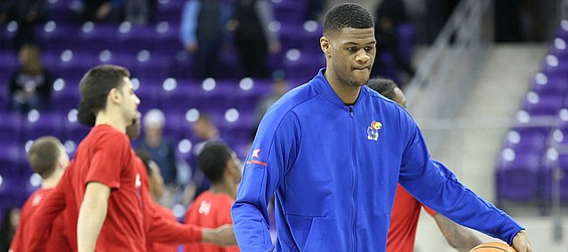 Kansas forward Billy Preston dribbles a ball at half court as his teammates get stretched prior to tipoff against TCU, Saturday, Jan. 6, 2018 at Schollmaier Arena.
