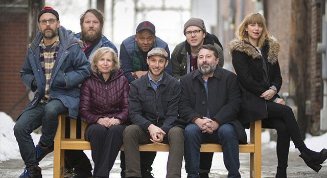 Many of the Lawrence Songbook collaborators are pictured on Thursday, Jan. 18, 2018. Sitting at left is songbook committee member and musical artist Jeff Stolz, Lawrence Public Library director of development and community partnerships Kathleen Morgan, songbook creator and Lawrence artist Nicholas Ward, Lawrence Public Library executive director Brad Allen, and songbook committee member and Lawrence musician Heidi Lynn Gluck. In back from left are songbook illustrator Adam Lott, songbook committee member and musical artist Sean Hunt, a.k.a Approach, and songbook visual art director Nicholas Stahl.