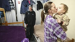Alta Dodson gives her 2-year-old daughter Kristin a kiss after Dodson and her partner Sam Maddux tidied up their quarters at the Lawrence Community Shelter, 3655 E. 25th St., on Wednesday, Jan. 17, 2018. Dodson and Maddux have five children staying with them at the shelter, which is allowed to accept extra people on a temporary basis when the weather is cold.