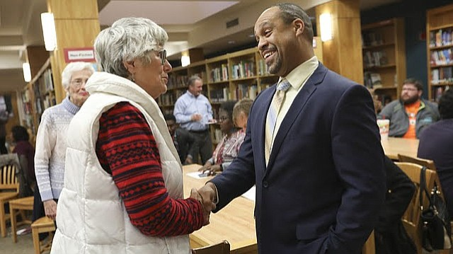 Jayson Strickland introduces himself to Carladyne Knox Conyers during a meet and greet on Wednesday, Jan. 24, 2018 at Lawrence High School. Strickland is one of two final candidates for the Lawrence school district's superintendent position.