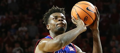 Kansas center Udoka Azubuike (35) shoots a free throw during the second half at Lloyd Noble Center on Tuesday, Jan. 23, 2018 in Norman, Oklahoma.