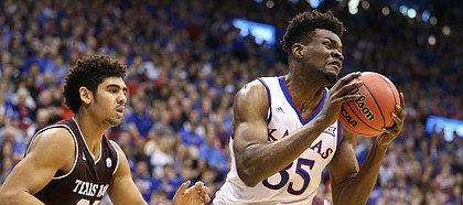 Kansas center Udoka Azubuike (35) pulls a rebound from Texas A&M center Tyler Davis (34) during the first half, Saturday, Jan. 27, 2018 at Allen Fieldhouse.