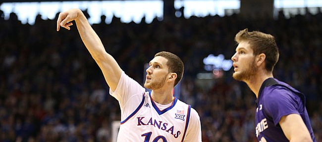 Kansas guard Sviatoslav Mykhailiuk (10) hangs his hand after hitting a three against Kansas State forward Dean Wade (32) during the first half, Saturday, Jan. 13, 2018 at Allen Fieldhouse.