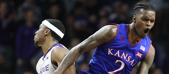 Kansas guard Lagerald Vick (2) protests a foul called against him during the first half, Monday, Jan. 29, 2018 at Bramlage Coliseum in Manhattan, Kan. At left is Kansas State forward Xavier Sneed (20).