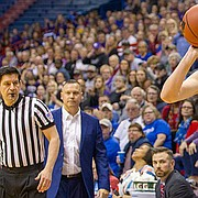 Kansas guard Kylee Kopatich (33) sets up for a 3-pointer late in the fourth quarter Sunday against Kansas State at Allen Fieldhouse.