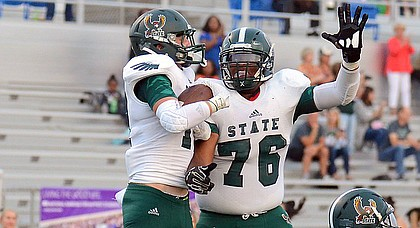 Jake Rittman and Jalan Robinson celebrate after Rittman scored for Free State against Shawnee Mission West during the first quarter on Friday, Sept. 1, 2017 at Shawnee Mission South District Stadium.