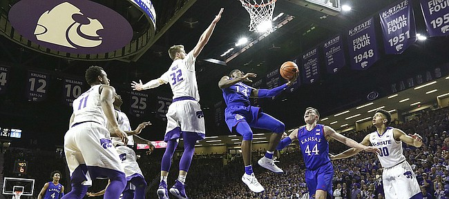 Kansas guard Malik Newman (14) gets under Kansas State forward Dean Wade (32) for a bucket late during the second half, Monday, Jan. 29, 2018 at Bramlage Coliseum in Manhattan, Kan.