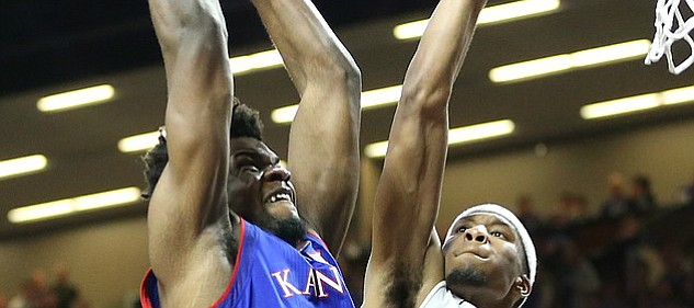 Kansas center Udoka Azubuike (35) is fouled on a dunk by Kansas State forward Xavier Sneed (20) during the second half, Monday, Jan. 29, 2018 at Bramlage Coliseum in Manhattan, Kan.