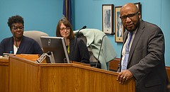 Anthony Lewis, the newly approved district superintendent, speaks at the Lawrence school board meeting on Monday, Jan. 29, 2018 at the USD 497 district headquarters, 110 McDonald Drive. Behind him are board members Melissa Johnson, left, and Kelly Jones.