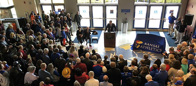 "Former KU coach Ted Owens sits aside former player Isaac ""Bud"" Stallworth as part of a bench-dedication ceremony held in Allen Fieldhouse on Saturday."