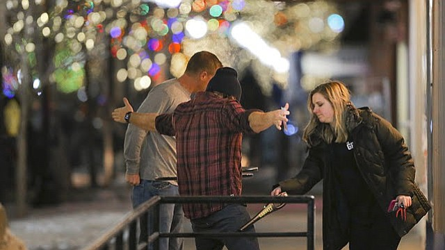 A Granada employee wands two patrons before entering the venue on Thursday, Jan. 18, 2018.