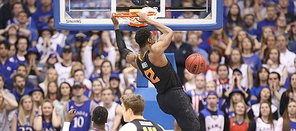 Oklahoma State forward Cameron McGriff (12) delivers a dunk during the second half, Saturday, Feb. 3, 2018 at Allen Fieldhouse.