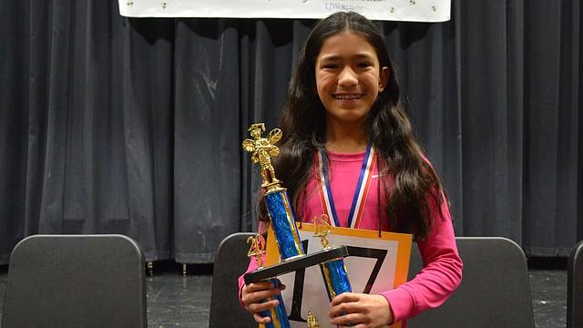 "Raintree Montessori School student Zoe Cachiguango-Latta won the Douglas County Spelling Bee by correctly spelling the word ""repugnant"" on Saturday, Feb. 3, 2018 at Southwest Middle School."