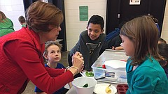 Sue Willoughby, a Title I math and reading teacher, demonstrates how to crack an egg during a cooking lesson Friday, Feb. 2, 2017 at Hillcrest Elementary School. Looking on, from left, are third-graders Sebastian Iversen, Eyad Eissa and Julia Johnson.