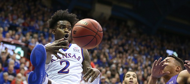 Kansas guard Lagerald Vick (2) throws a pass across the baseline beyond TCU guard Kenrich Williams (34) and TCU guard Desmond Bane (1) during the second half on Tuesday, Feb. 6, 2018 at Allen Fieldhouse.