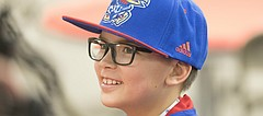 Tayber Witt, an 11-year-old from Tonganoxie smiles as he takes questions from media members following Kansas football head coach David Beaty's National Signing Day press conference on Wednesday, Feb. 7, 2018 at the Anderson Family Football Complex. Witt, who lives with a genetic disorder, became an unofficial member of the team and will attend practices, games and team functions.