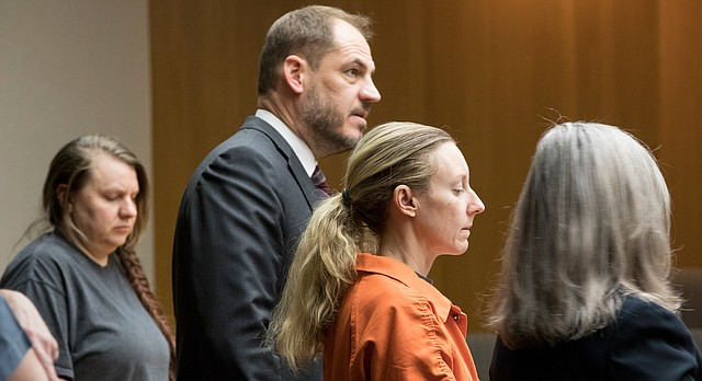 Defendant Tria Evans, 38, of Lawrence, second from right, stands with her attorney, Carol Cline, during an appearance before Judge Kay Huff on Tuesday, Feb. 6, 2018, in Douglas County District Court. Also pictured is Christina Towell, 37, of Leavenworth, far left, next to her attorney, Michael Clarke. The two are accused of killing Joel Wales, whose body was found in a burning home.