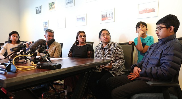 Angela Zaynub Chowdhury, third from right, speaks Thursday, Feb. 8, 2018, at a news conference about a temporary stay of removal issued for her husband, Bangladeshi-born Lawrence scientist Syed Jamal, who was recently arrested by Immigration and Customs Enforcement agents and faced deportation. Chowdhury was joined Thursday at the Kansas City, Mo., offices of Sharma-Crawford Attorneys at Law by the family's attorney, Rekha Sharma-Crawford, third from left, her brother-in-law Syed Hussein Jamal, second from left, and her three children, Naheen, left, Fareed and Taseen, right.