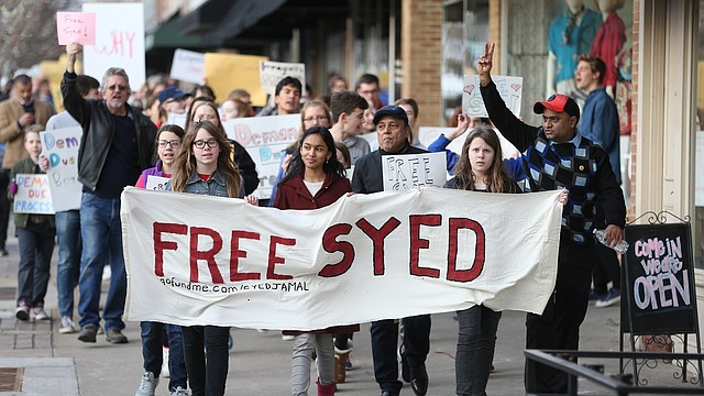 Naheen Jamal, 12-year-old daughter of Syed Jamal, center, is flanked by her friends Elizabeth Anderson, left, and Anna Anderson as they lead a Free Syed Jamal march on Thursday, Feb. 8, 2018 at Lawrence Creates. Jamal, a Bangladeshi-born Lawrence resident, research scientist and academic, was detained by ICE on Jan. 24. Jamal was issued a temporary stay of deportation on Wednesday.