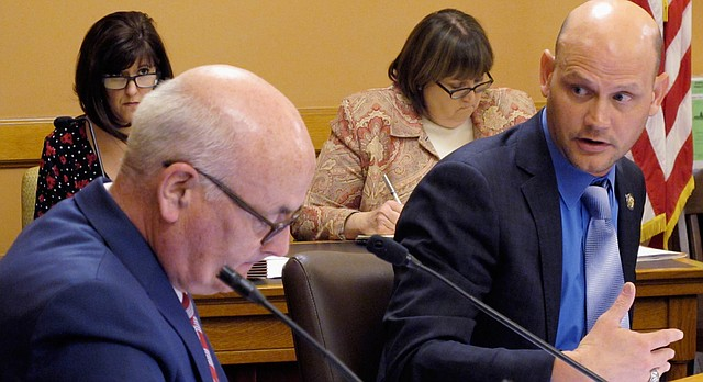 Kansas House Speaker Pro Tem Scott Schwab, right, R-Olathe, asks a question of House Minority Leader Jim Ward, left, D-Wichita, during a discussion among top lawmakers about the Legislature's sexual harassment policy, Friday, Feb. 9, 2018, at the Statehouse in Topeka, Kan.  (AP Photo/John Hanna)