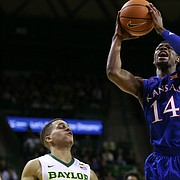 Kansas guard Malik Newman (14) heads to the bucket between several Baylor players during the first half, Saturday, Feb. 11, 2018 at Ferrell Center in Waco, Texas.