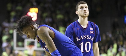 Kansas guard Lagerald Vick (2) and Kansas guard Sviatoslav Mykhailiuk (10) show their frustration following a late foul against the Jayhawks with little time remaining in the game, Saturday, Feb. 11, 2018 at Ferrell Center in Waco, Texas.