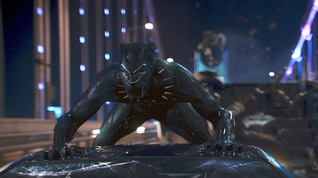 """This image released by Disney shows a scene from Marvel Studios' """"Black Panther."""" South Middle School launched a GoFundMe page last month with the goal of providing tickets for students to watch the film, which has been hailed as a landmark black superhero movie."""